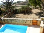 GUNO holiday house swimming pool area with view seen from roof terrace