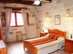 GUNO holiday house double bedroom with ceiling fan