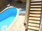 BALLUTA holiday house pool area with stairs leading to bedrooms patio