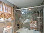 Rinse off after a long day on the lake in the full bathroom with shower/tub combo.