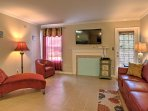 The plush furniture in the living room is the perfect place to relax and watch TV after a busy day.