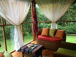 Living area with wildlife & nature filled views, comfy seating & a hammock!