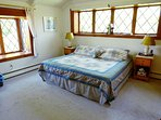First floor master bedroom with king bed with AC unit