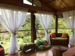 Living area with 270 degrees of wildlife & nature filled views, comfy seating & hammocks!