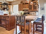 Equipped with rustic wood cabinetry, ample counter space and all your essential appliances, this kitchen makes meal...