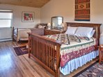 The third bedroom is equipped with a queen bed and twin bed.