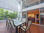 Private backyard entertaining area with wooden decking and plumbed in gas bbq