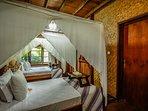 Twin bedroom in Villa Kayu.