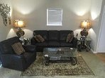 Three seater leather settee  and recliner chair