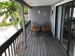 south facing balcony. Trex deck. Bistro table with four chairs