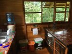 Kitchen comes with all essential dishware, drinking water, recycling, garbage,compost & nature views