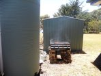 Barbecue and rainwater tank