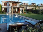 The northen view of the villa with private swimming-pool and garden