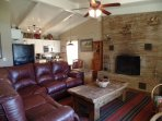 Comfortable Leather Reclining Living Room Sofa with a Fireplace.