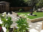 Garden with BBQ table chairs and loungers