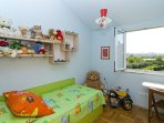 This is bedroom for your  superkids. There is a big wardrobe too, and table with chairs.