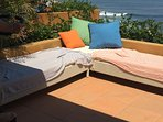 Rooftop seating-waves and surf in background