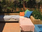 Rooftop seating-chaise lounges-private suntan deck.