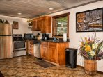 Stainless steel appliances, fully stocked with all cooking needs
