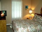Another view of Kahuna bedroom -- Queen, HDTV with built-in DVD, celing fan, clock radio