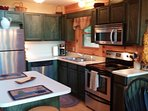 Kitchen that is open to family room and dining room with all the essentials.
