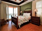 MASTER BEDROOM TO BALCONY WITH GREAT WATER VIEWS.