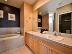 MASTER BATH HAS  DUAL VANITIES/ SOAKING TUB .