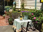 Arcata Stay's Rose Court Cottage studio vacation rental courtyard guest seating