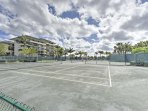 Play a friendly match of tennis before heading to the beach.