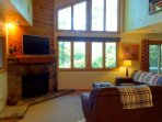 Large picture windows with mountain views. Enjoy the wood burning fireplace on cold evenings.