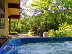 Relax in the outdoor hot tub after a day on the trails.