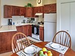 The kitchen opens up to the dining space with a table that seats 4.