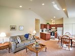 The plush furniture in the large living room is perfect for relaxing after a long day on the golf course.