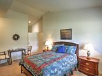 The master bedroom has a queen-sized bed, along with an en suite bathroom and a private kitchenette with a microwave...