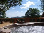 Relax and unwind in the hot tub on the deck, which offers magnificent views.