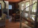 View into the dining area with antique table and seating for four. Lots of windows to view wildlife!