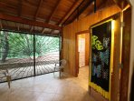 Secure, gated back porch with entrance to 3rd bedroom