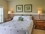 Get a good night's sleep in this plush master bedroom.