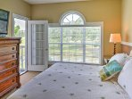 The master bedroom offers a comfy king bed.