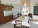Large Kitchen Livingroom, with dishwasher, ice maker, microwave, oven, freezer. Double sofa bed
