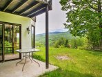 Up to 5 guests can relax on the back deck after a day exploring New Hampshire.