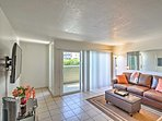 Pristine tile floors, mirrored surfaces and a tall sliding glass door brighten the condo, making it feel even larger!