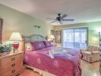 The master bedroom boasts a king bed, flat-screen cable TV and doors to access the patio.