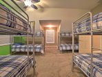 The 8 twin-over-twin bunk beds in the room are perfect for the kids in your group.