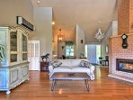 The open, high-ceiling living and dining room areas have rich bamboo floors.
