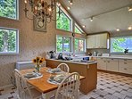 The fully equipped eat-in kitchen has ceramic tile floors & custom German cabinetry.