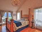 The spacious master bedroom features a grand queen bed.