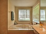 The master bath features a double walk-in shower and an inviting Jacuzzi.