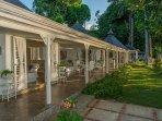 Its rooms stretch along a 100' marble verandah ...