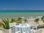 Days start with eye-opener coffee silently placed at bedroom doors and fresh fruits served over the beach.